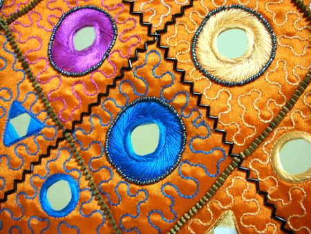 Embroidery work - Exquisite handicraft work with mirrors sewn into the fabric Stock Photo - 449777