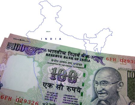 Indian currency  one hundred rupees with Gandhi emblem against the outline of India map photo