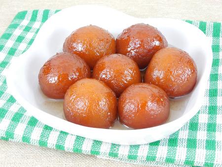 gulab: Gulab jamun, a delicious Indian sweet dish.