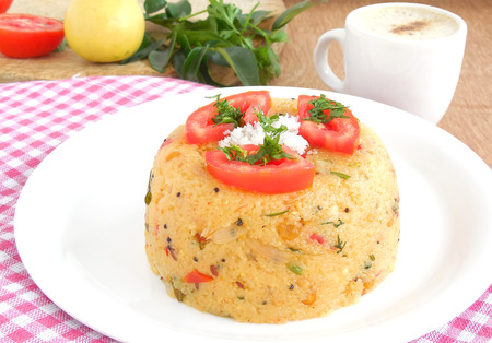 gratings: Khara bath, an Indian dish, typically prepared for breakfast,  made from semolina. Stock Photo