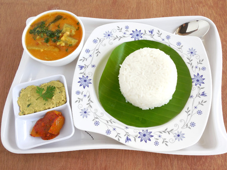 south indian: Simple south Indian vegetarian meal, consisting of rice, sambar, chutney and lemon pickles.