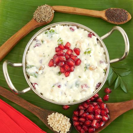 urad dal: Yogurt or curd rice in a wok.