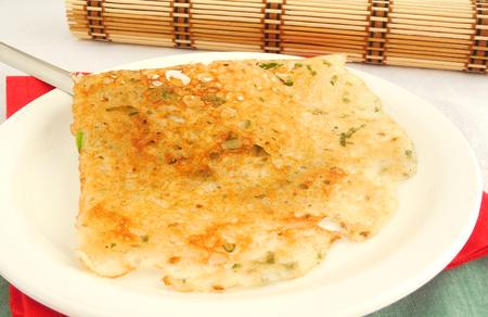 dosa: Rava dosa, a popular Indian breakfast made from rava or semolina batter. Stock Photo