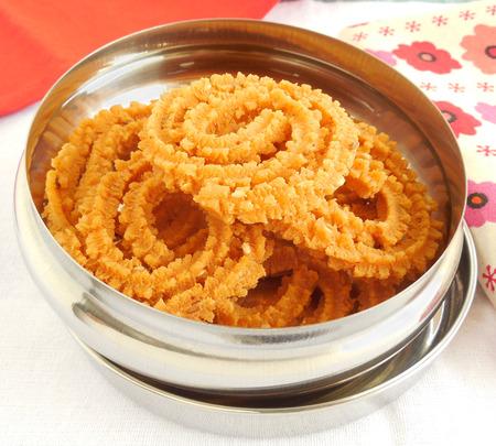 murukku: Home-made murukku, a traditional Indian vegetarian snack.