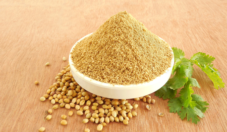 coriander seeds: Coriander powder and leaves in a bowl.