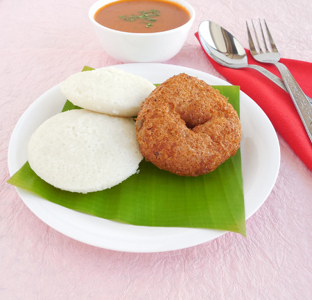 south indian: Idli, vada and sambar, a traditional and popular south Indian vegetarian breakfast and lunch items. Stock Photo