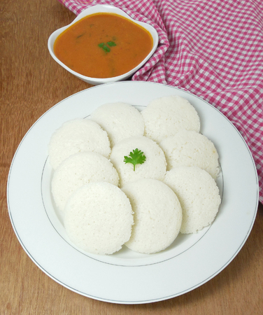 Idli, or rice cake, is a steam-cooked, traditional and popular south Indian vegetarian food eaten with sambar, a liquid dish.