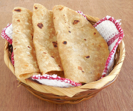 Indian food chapati or Indian flat bread is made wheat flour dough and is a traditional and popular cuisine.
