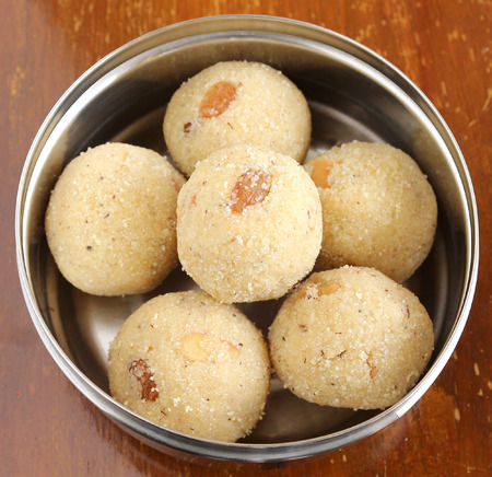 indian sweet: Indian sweet rava laddu, made from rava or semolina, is a delicious and traditional and popular dish. Stock Photo