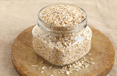 insoluble: Healthy food oats, which is said to be a source of insoluble fiber, in a bottle.