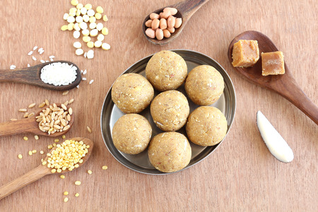 Indian sweet laddu, a traditional and popular food, made from multi grains like wheat, rice, split mung, roasted gram, coconut and jaggery. Stock Photo