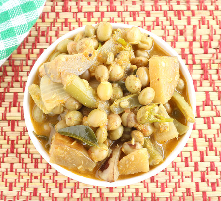 side dish: Indian food home-made vegetarian curry, prepared from vegetables like eggplant, peas, tomato and onion, is used as a side dish for items like chapati. Stock Photo
