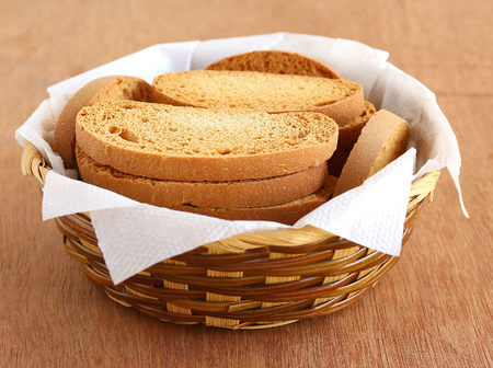 rusk: Healthy snack rusk, made from whole-wheat flour, in a basket. Stock Photo
