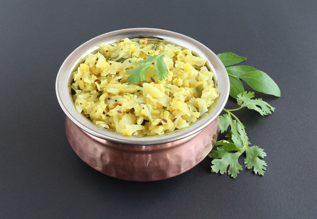 side dish: Cabbage and mung curry, an Indian side dish, in a copper bowl.