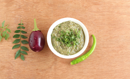 chutney: Indian food eggplant chutney, also known as brinjal chutney, is a vegetarian, healthy, traditional and popular side dish for items like chapati and roti. Stock Photo