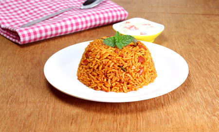 Indian homemade traditional food rice pilaf on a plate. Standard-Bild