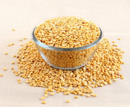 Indian food toor dal, also known as split pigeon pea, rich in proteins, in a glass bowl. Stock Photo