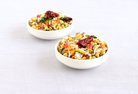gratings: Kosambari, a traditional and popular, south Indian salad made from split mung bean, lentil, cucumber and other items.