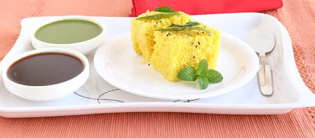 indian mustard: Dhokla, an Indian vegetarian food native to Gujarat state, India, in a plate.