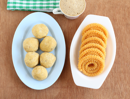 Besan laddu, which is a sweet dish, and chakli, also known as murukku, which is a snack, and filter coffee.