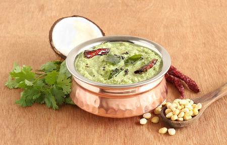 Coconut chutney, which is a traditional and popular vegetarian Indian side dish, with its main ingredients.