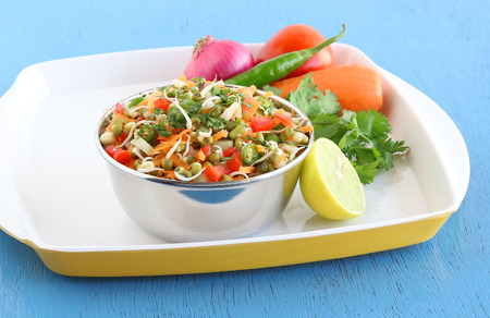 Sprouted moong salad, an healthy Indian vegetarian side dish, which is a rich source of nutrients, in a steel bowl. Stock Photo