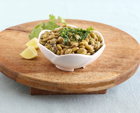 Avarekai palya or hyacinth beans curry, a home cooked south Indian vegetarian side dish, in a bowl on a wooden table. 版權商用圖片