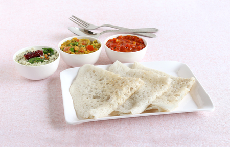 Neer dosa, a south Indian traditional, popular and vegetarian crepe or dish, with coconut and tomato chuntey and vegetable curry as side dishes. Reklamní fotografie