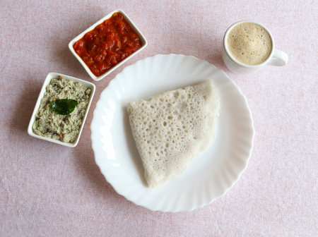 Neer dosa, a south Indian traditional, popular and vegetarian crepe or dish, with coconut and tomato chuntey as side dishes, and coffee.