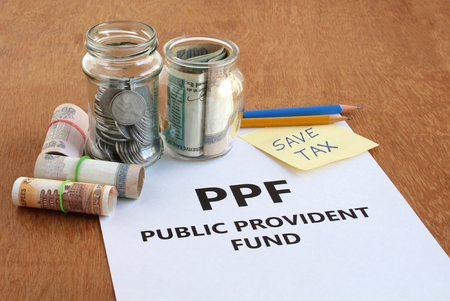 Investment of Indian rupees in public provident fund (ppf), a low-risk investment option, for saving tax, concept.