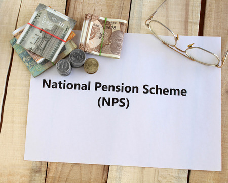 Investment of Indian rupees in National Pension Scheme (NPS) concept, highlighted with Indian money and reading glasses.