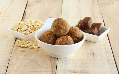 Laddu or maladdu, an Indian sweet dish for festivals like Maha Shivratri, Dasara and Diwali, made from roasted gram, jaggery, and almonds.