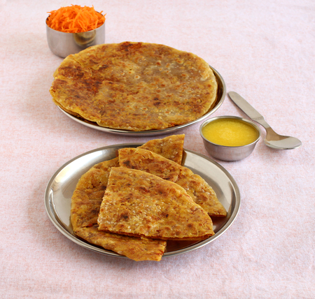 Carrot puran poli, holige or obbattu, an Indian vegetarian home cooked sweet dish, which is typically eaten with ghee or clarified butter as the topping. Imagens