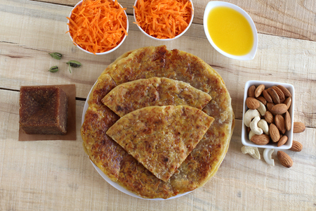 Carrot puran poli, holige or obbattu, an Indian vegetarian home cooked sweet dish, and its key ingredients.