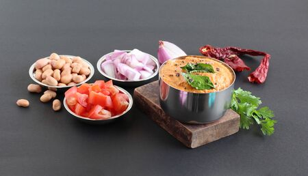 Onion and tomato chutney, a healthy Indian vegetarian side dish for items like chapati, roti, idli and dosa, with its main ingredients.