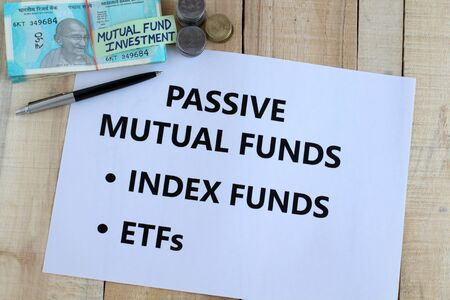 Passive mutual funds, which include index and exchange traded funds or etfs, an investment in Indian rupees concept.