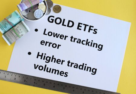 Gold exchange traded funds, or ETFs, an investment in Indian rupees concept, highlighting two of the key buying traits.
