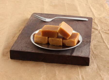 Mysore pak, a traditional, popular, and delicious sweet dish native to the city of Mysore, Karnataka, India, is made from ingredients like gram flour, ghee and sugar.