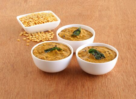 Toor dal chutney, an Indian, delicious, healthy, and vegetarian side dish for items like idli, dosa, chapati, and roti, in three bowls. Stock Photo