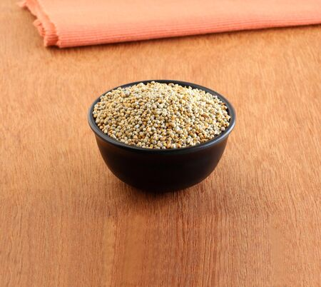 Pearl millet, a gluten-free healthy food is said to be rich in antioxidants, dietary fiber, vitamin B, minerals like phosphorus, manganese, and copper, in a bowl.