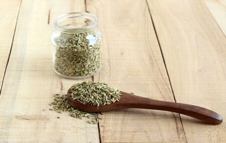 Fennel seeds, or soumph, a healthy food, are said to aid digestion and work as a mouth freshener, on a wooden spoon.