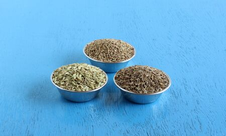Carom seeds, caraway seeds, and fennel seeds, which are said to have health benefits, in steel bowls.