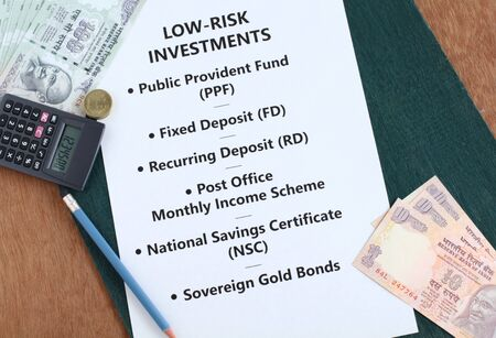Low risk Indian rupees investment options, such as public provident fund, fixed deposit, recurring deposit, post office monthly income scheme, national savings certificate and sovereign gold bonds, concept.