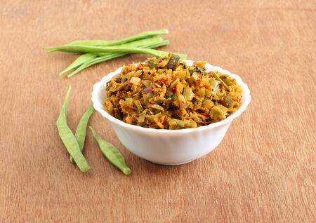 Cluster beans curry, also known as gawar ki sabzi, is a healthy, Indian, and vegetarian side dish for items like chapathi and roti. Stock Photo