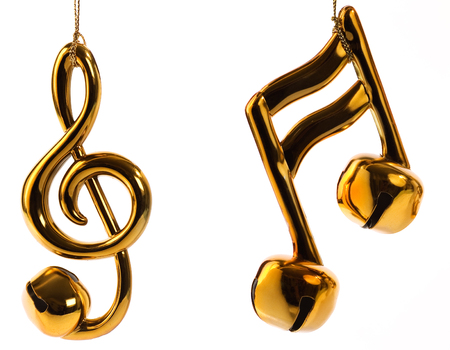 g clef: Beamed sixteenth note, and treble clef jingle bell Christmas ornaments isolated on white background.