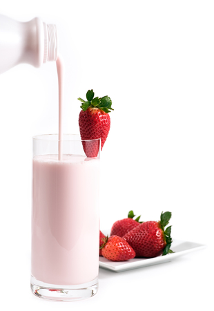 vitamines: Strawberry kefir, cultured milk similar to a yogurt drink. Rich with vitamines A & D and calcium. A healthy drink for anyone wishing to add probiotics to their diet. Stock Photo