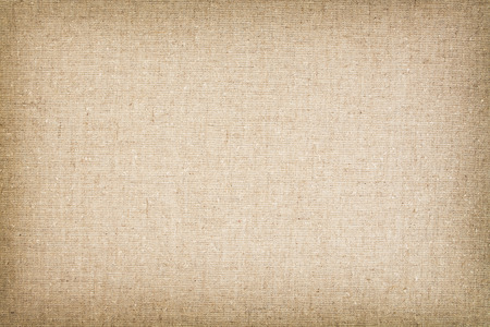 varying: High resolution canvas  cotton woven fabric with flecks of varying colors of beige and brown. Stock Photo