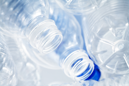 destined: Used plastic bottles destined for the recycle bin or landfill? Recycling concept image.