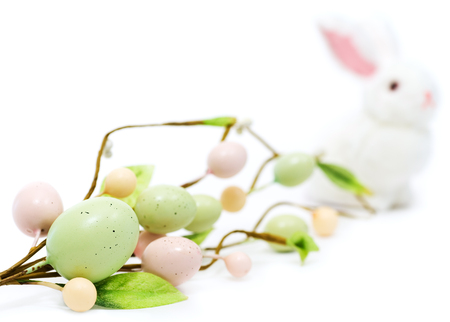 Decorative speckled Easter eggs and Easter Bunny on white background.