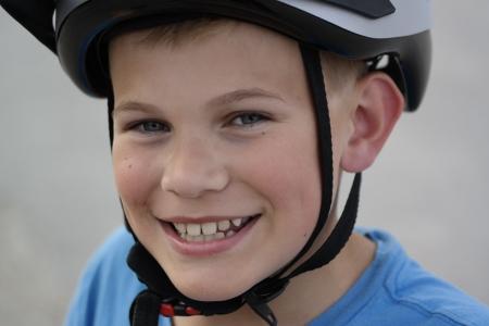 bicycle helmet: Smiling boy with bicycle helmet